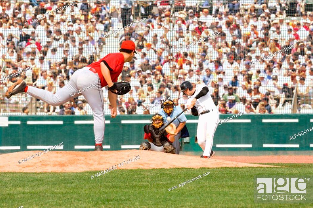 Stock Photo: Baseball player hitting a pitch.
