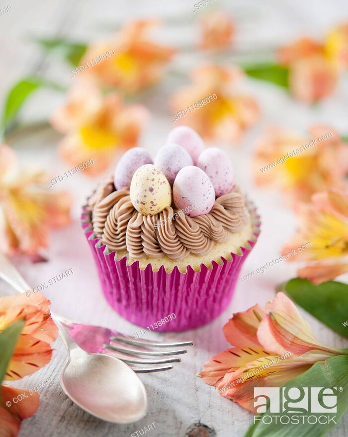 Photo de stock: An Easter cupcake decorated with chocolate cream and mini chocolate eggs.