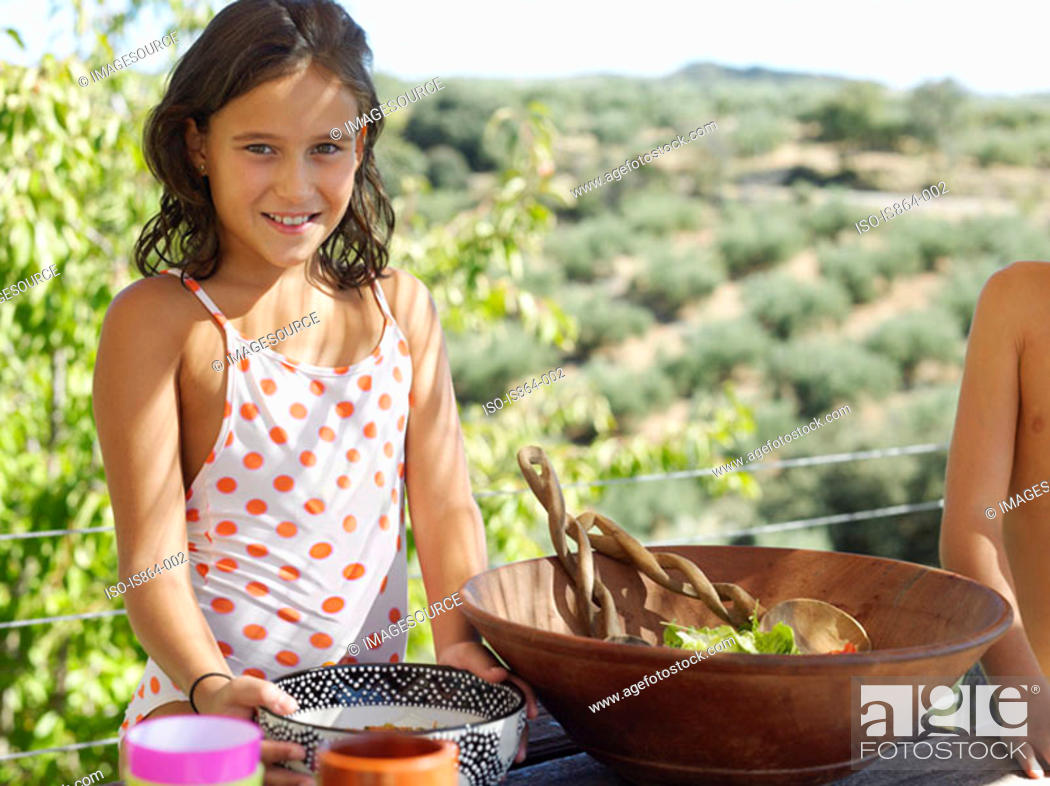 Stock Photo: Girl with bowls of food.