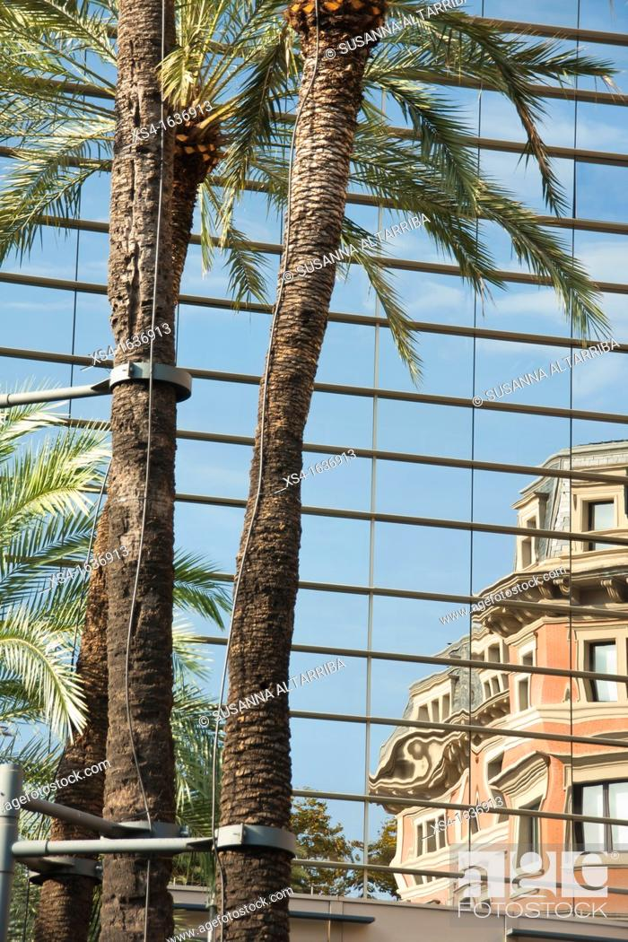 Stock Photo: Palm garden of the Palace of the Marquis de Santa Isabel, 1882-87 reflected in the new department within the Government of Catalonia.