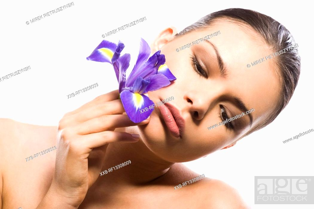 Stock Photo: young woman with purple flower.