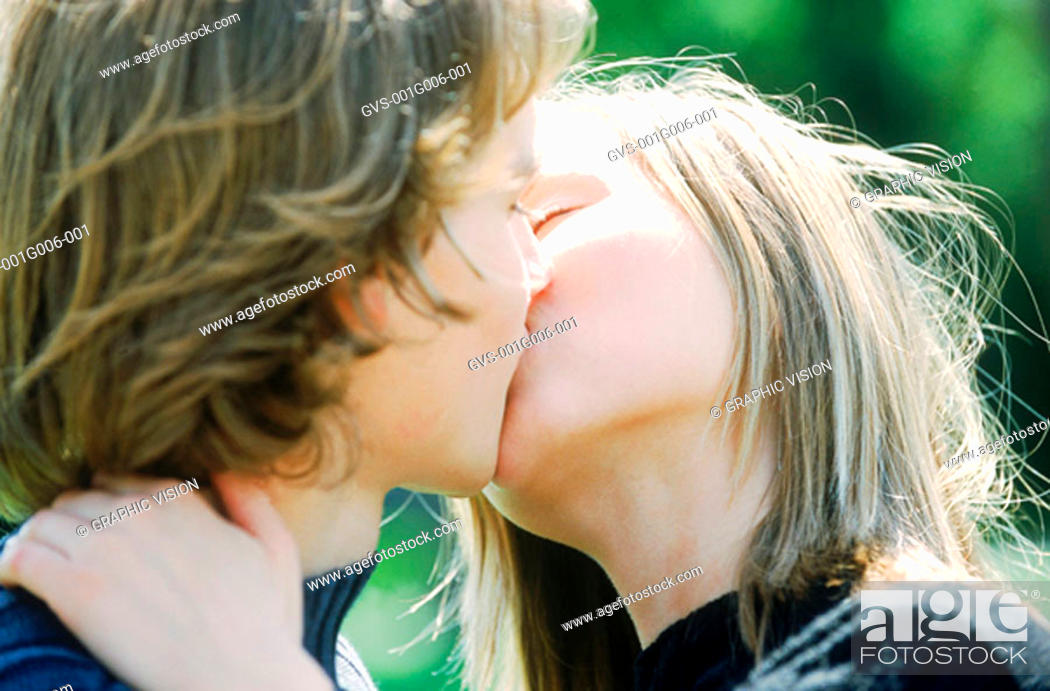 Stock Photo: Close-up of a young couple kissing.
