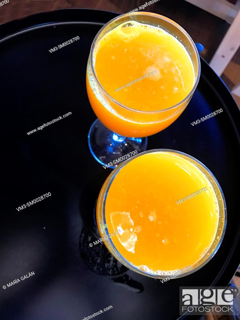 Stock Photo: Two glasses of orange juice. View from above.