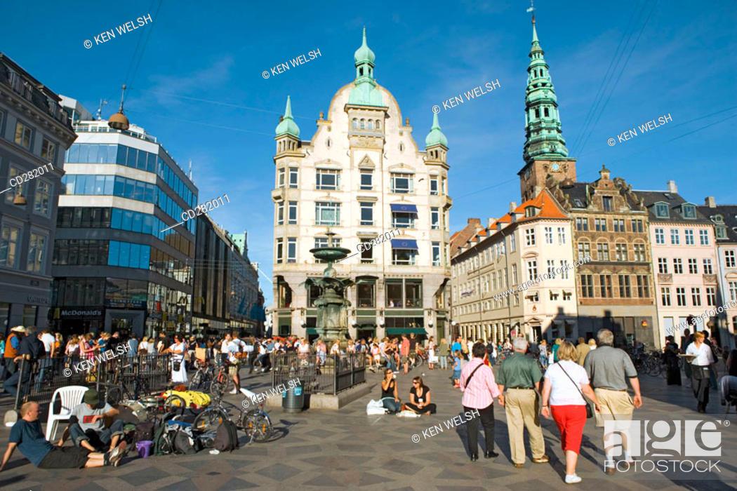 Stock Photo: Hojbro Plads on Stroget street and Spire of Nikolaj Kirke, now Nikolaj Copenhagen Contemporary Art Centre, Copenhagen, Denmark.