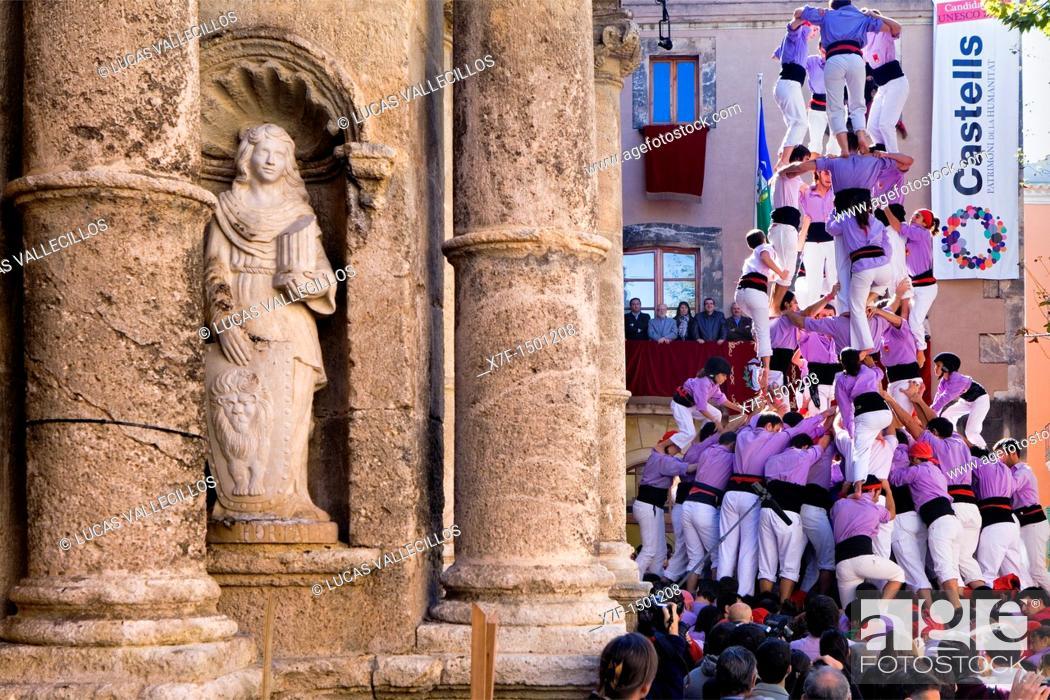 Stock Photo: Colla Jove Xiquets de Tarragona 'Castellers' building human tower, a Catalan tradition Fira de Santa Teresa, town festival  Plaça Vella El Vendrell Tarragona.