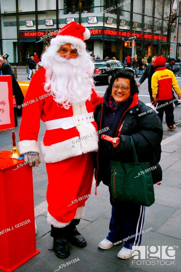 Stock Photo: Santa Claus with tourist. Manhattan. New York City, USA.