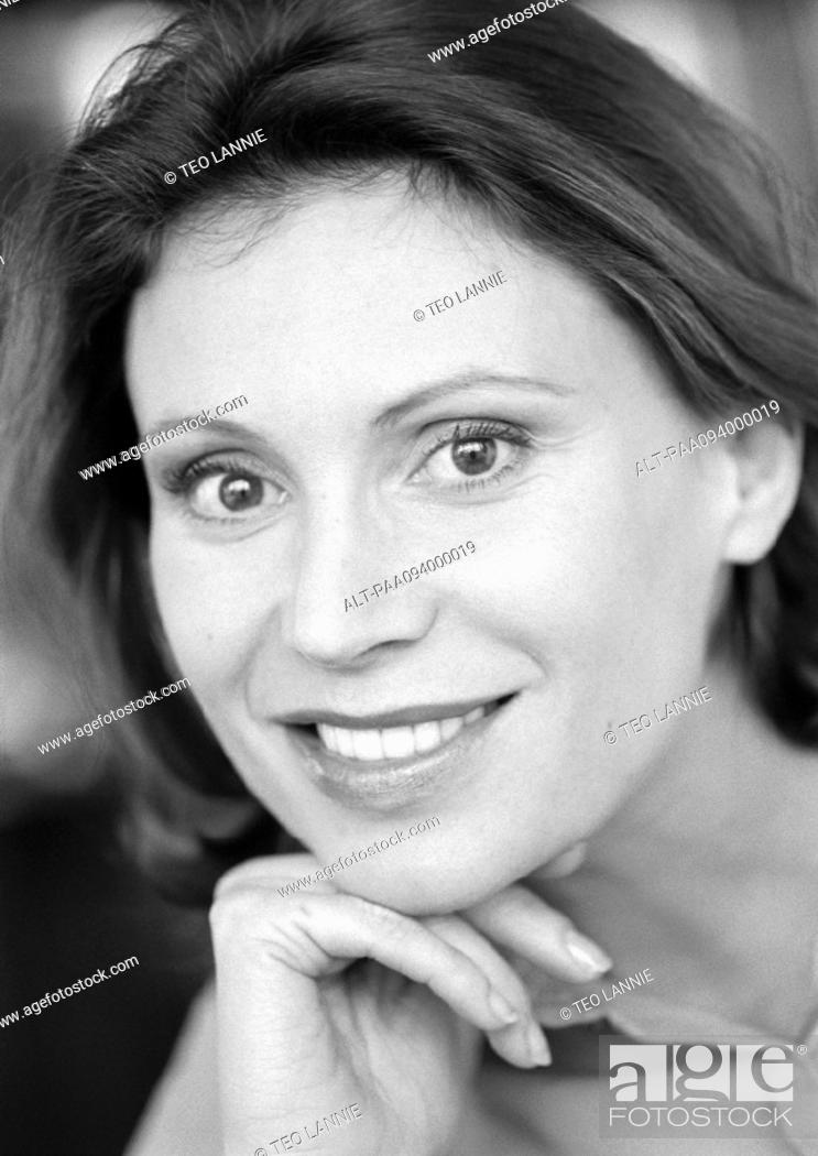 Stock Photo: Woman smiling, portrait, close-up, B&W.