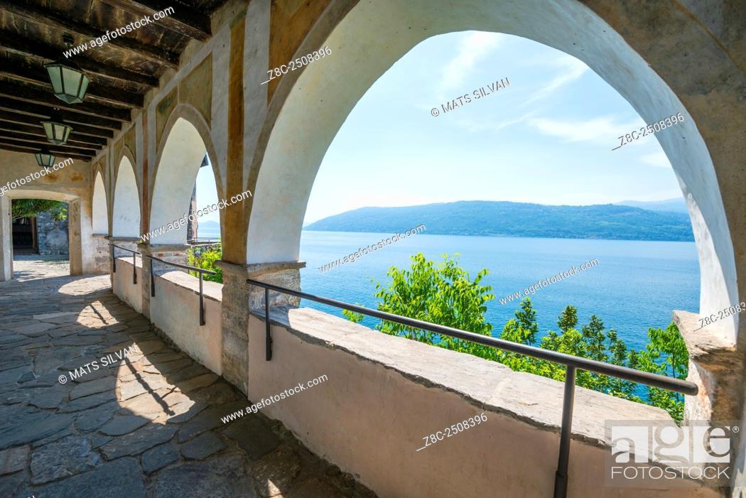 Stock Photo: Archway in Eremo di Santa Caterina del Sasso and lake Maggiore with mountain in a sunny day in Lombardy, Italy.