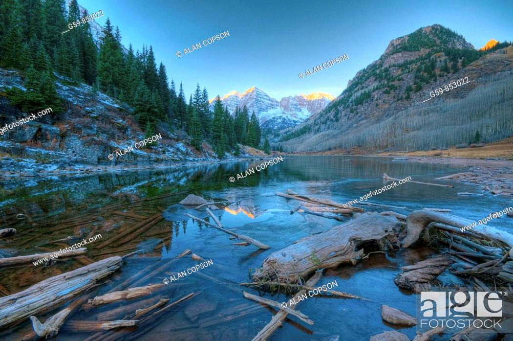 Stock Photo: USA, Colorado, Maroon Bells Mountain reflected in Maroon Lake.