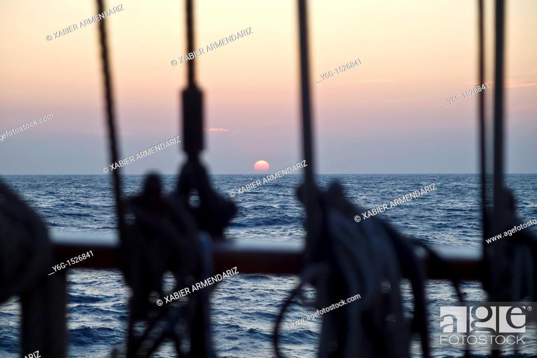 Stock Photo: Sunset aboard of tall ship Thalassa, North Sea, Europe.