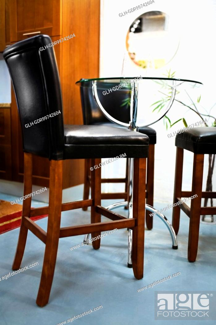 Photo de stock: Chairs in a dining room.