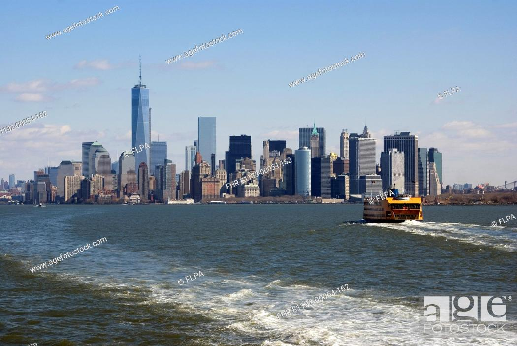Stock Photo: View of ferry on river and city skyline with One World Trade Center skyscraper, Hudson River, Lower Manhattan, Manhattan Island, New York City, New York State.