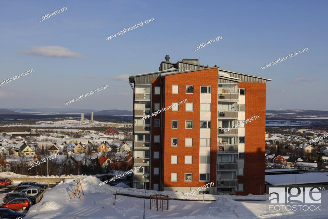 Stock Photo: Kiruna, Sweden, An apartment building in the spring with piles of snow.