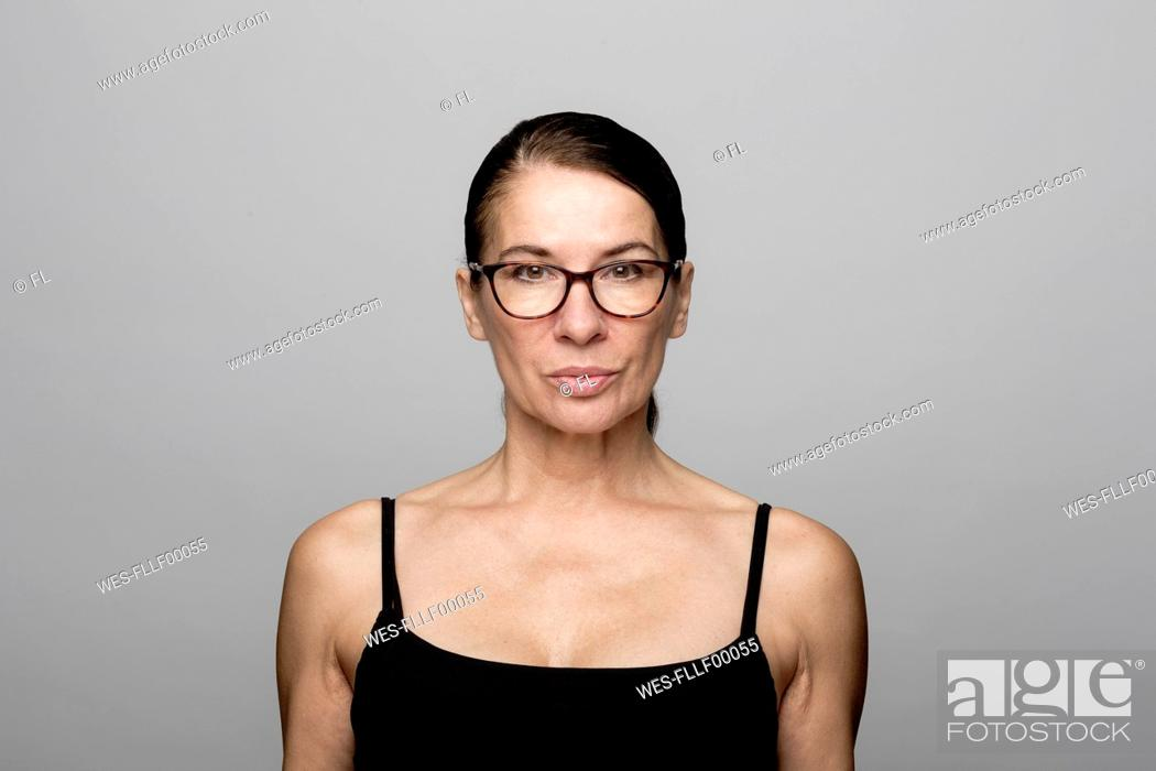 Stock Photo: Portrait of serious mature woman wearing glasses.
