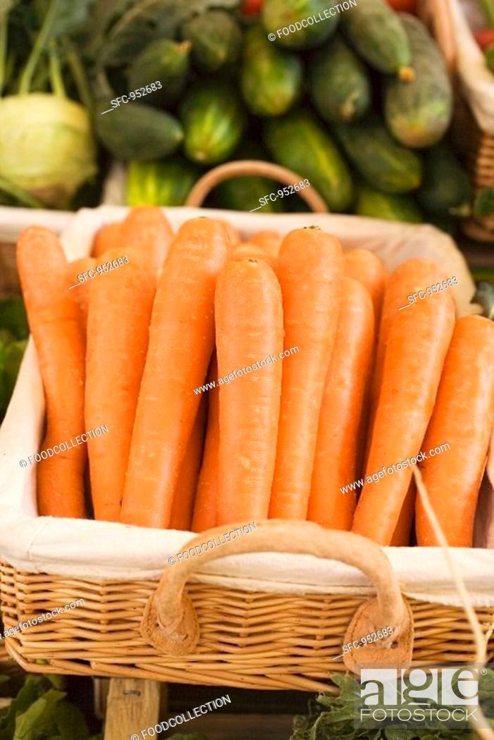 Stock Photo: Carrots in a basket at a market.