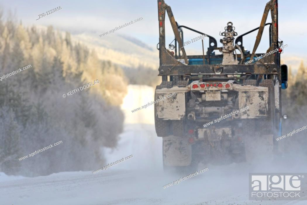 Stock Photo: Empty logging truck heading back for another load, Smithers, British Columbia.