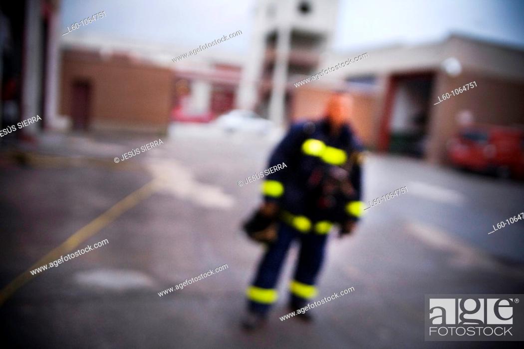 Stock Photo: Blurred Fireman.