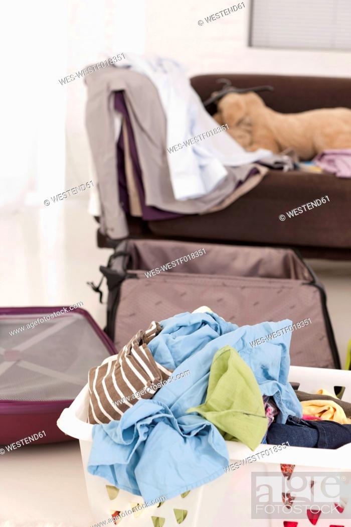Stock Photo: Germany, Leipzig, Unpacked suitcase in apartment.