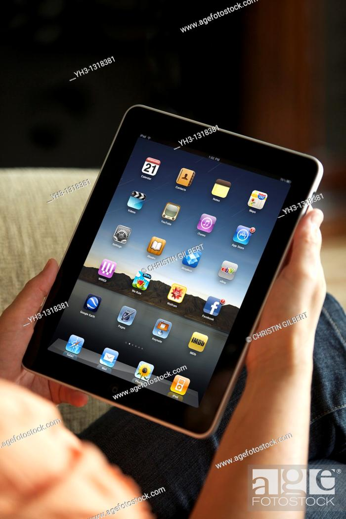 Stock Photo: Close up of a woman handholding an iPad.