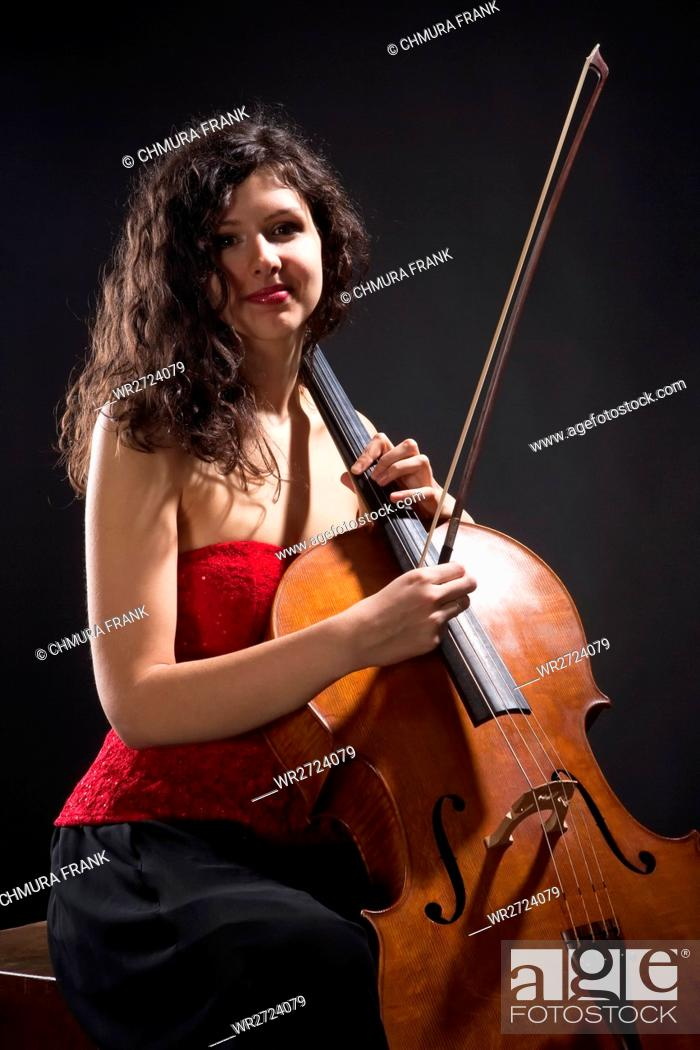 Stock Photo: Young Woman with Violoncello.