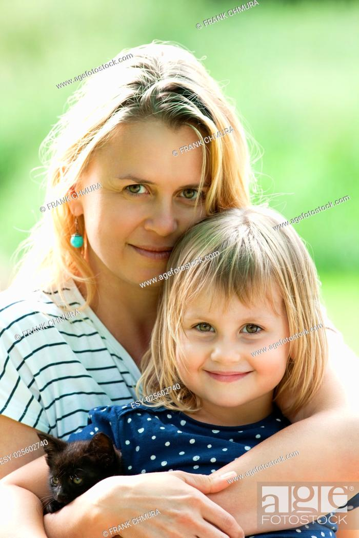 Stock Photo: Portrait of a Mother and Daughter with a Kitten.