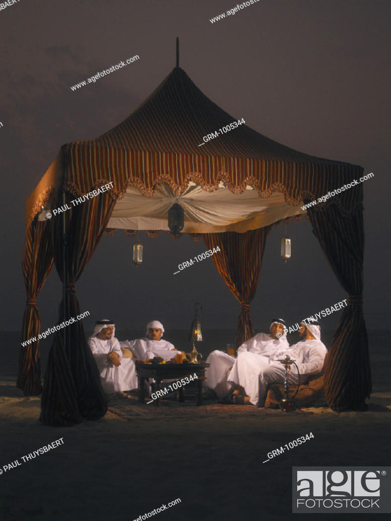 Stock Photo: Ramadan: Arab men sitting in Arabian tent for Iftar (fast-breaking meal after sunset).