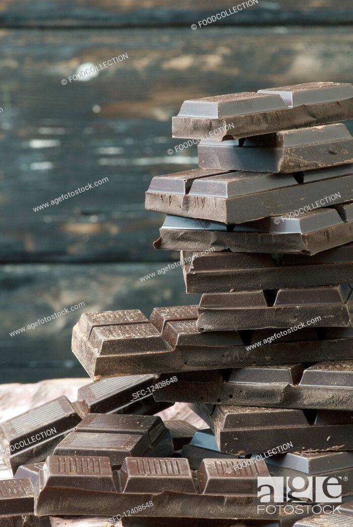Stock Photo: Stacked squares of chocolate.