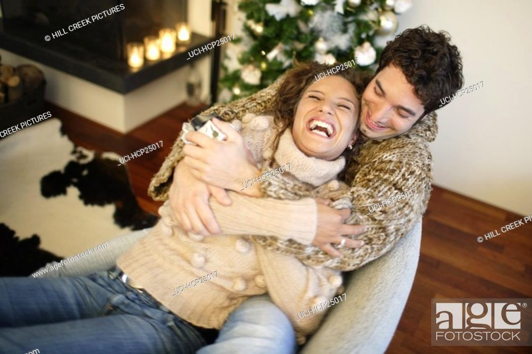 Stock Photo: Couple hugging on couch.
