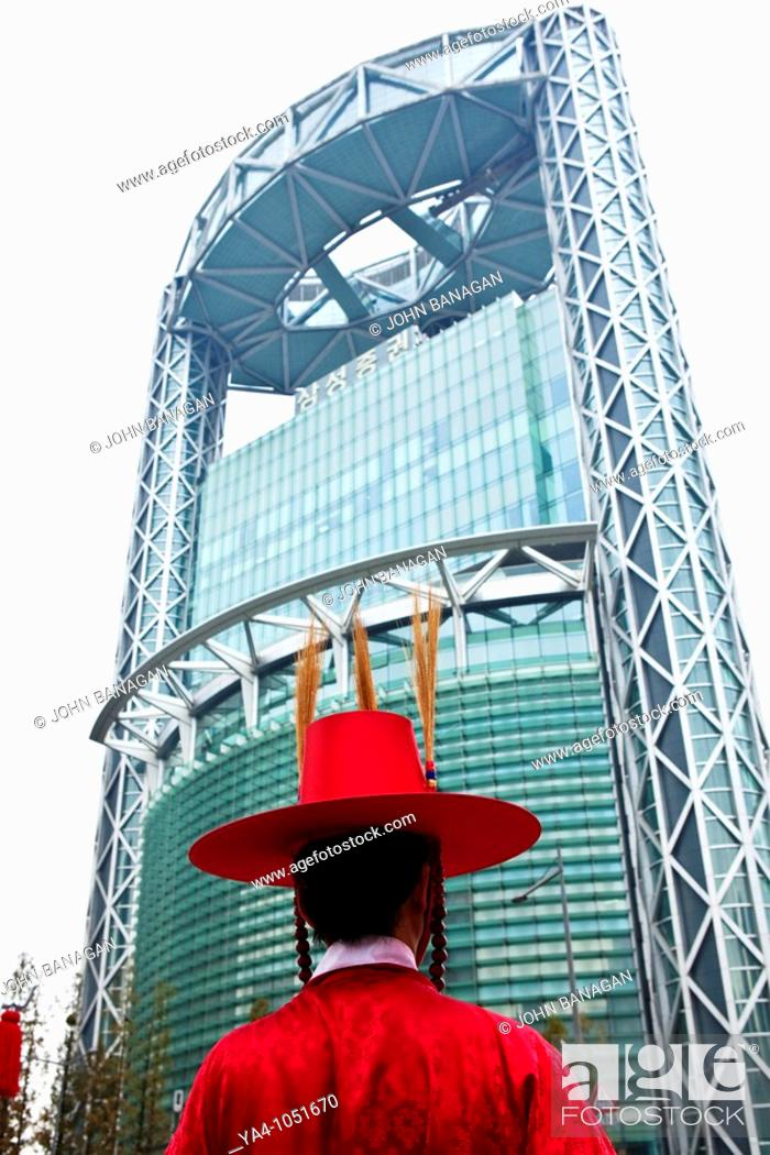 Stock Photo: The changing of ceremonial guards at Bosin-gak bell tower with the Jong No Tower in background.