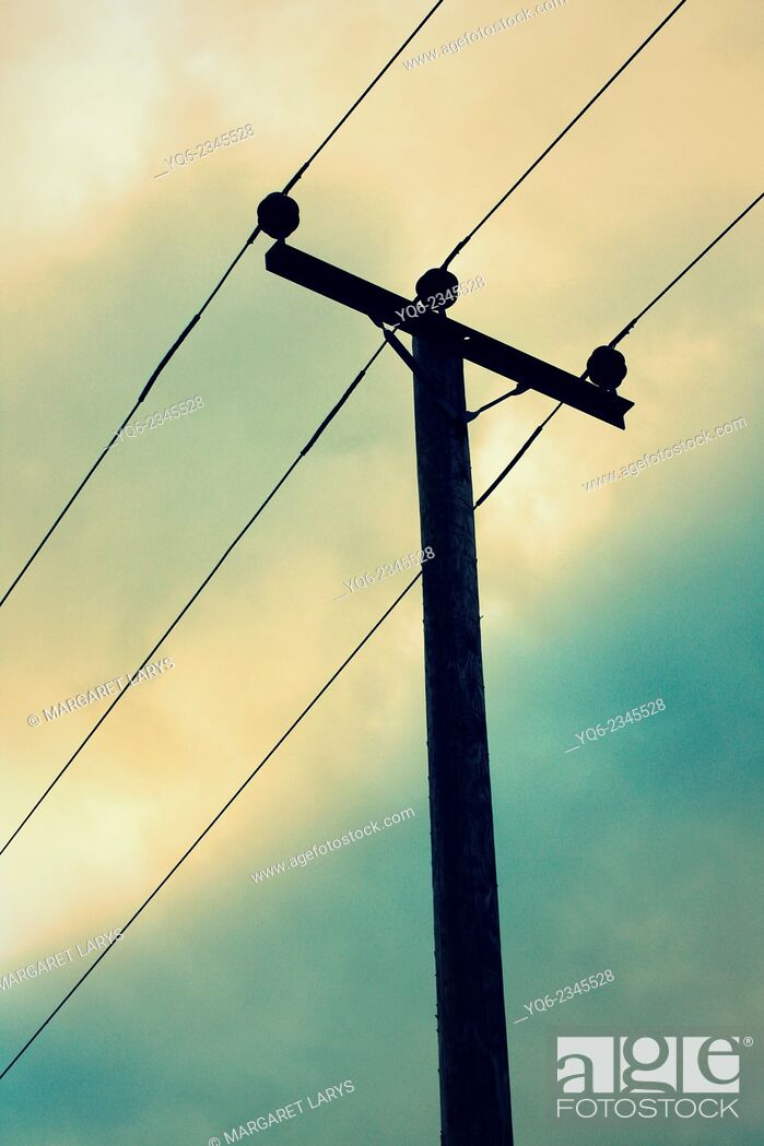 Stock Photo: Wooden telegraph pole and the afternoon sky.