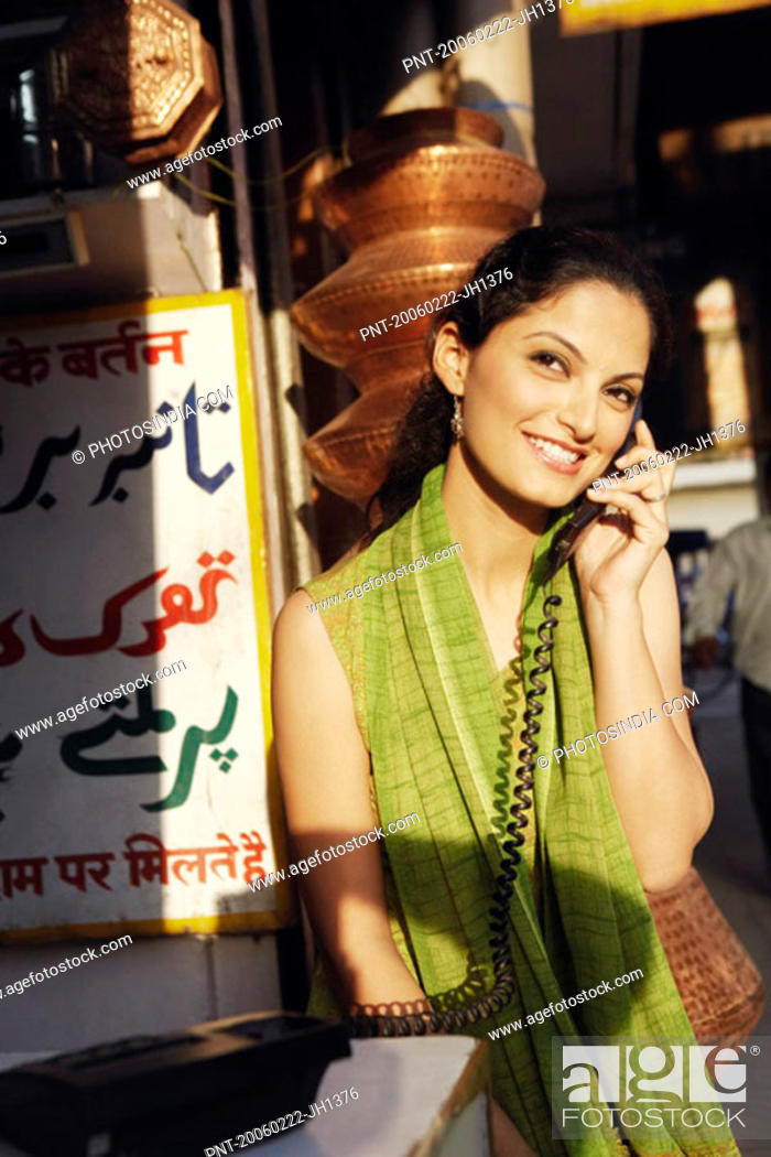 Stock Photo: Close-up of a young woman talking on the telephone.