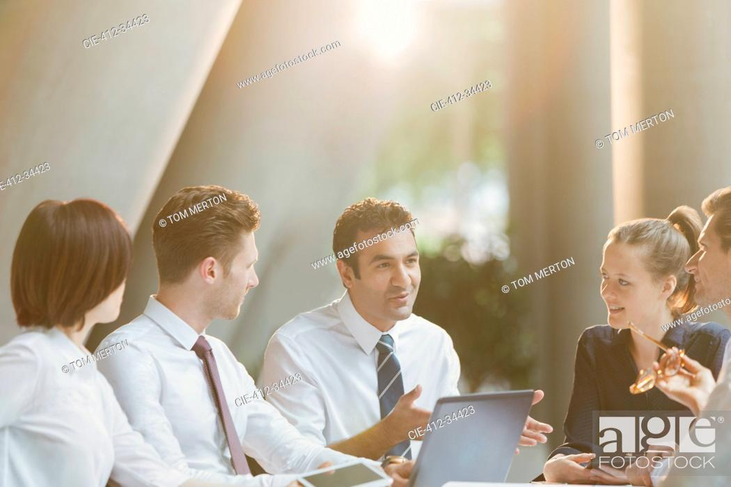 Stock Photo: Business people talking in conference room meeting.