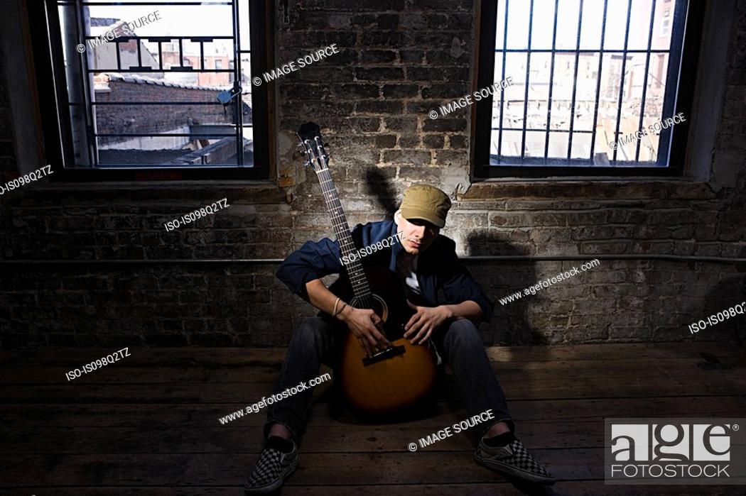 Stock Photo: Portrait of a guitarist.