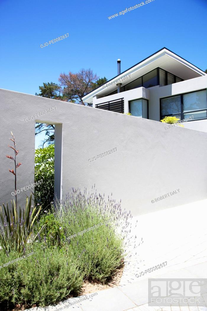 Stock Photo: Wall outside modern house.