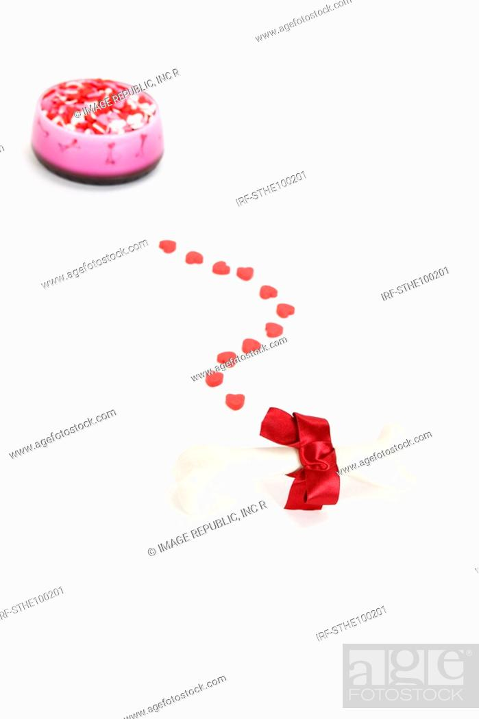 Stock Photo: pet toy and heart shaped sweets.
