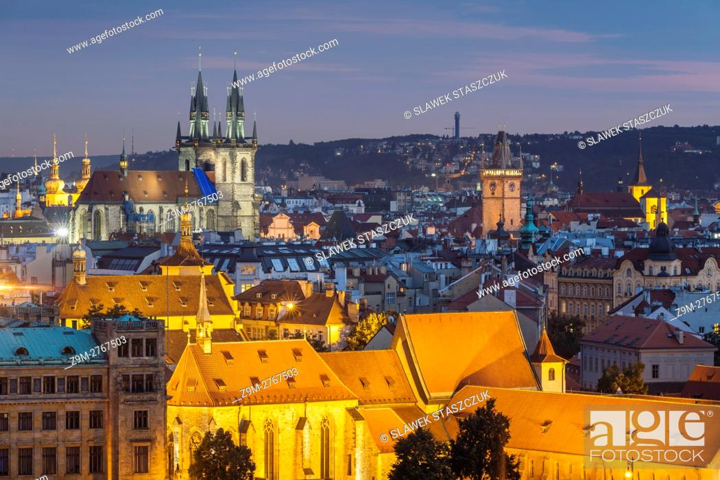 Stock Photo: Night falls in Prague old town, Czech Republic. . The medieval church of Our Lady before Tyn dominates the city skyline.