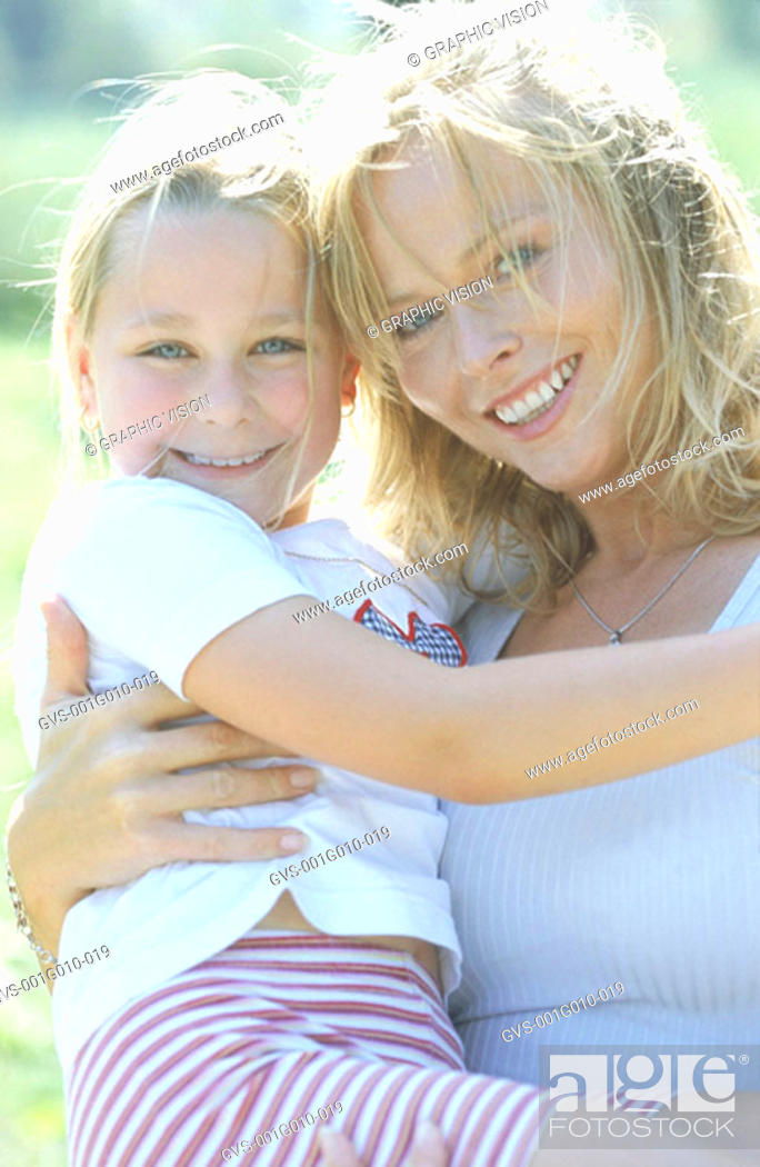 Stock Photo: Portrait of a mother holding daughter.