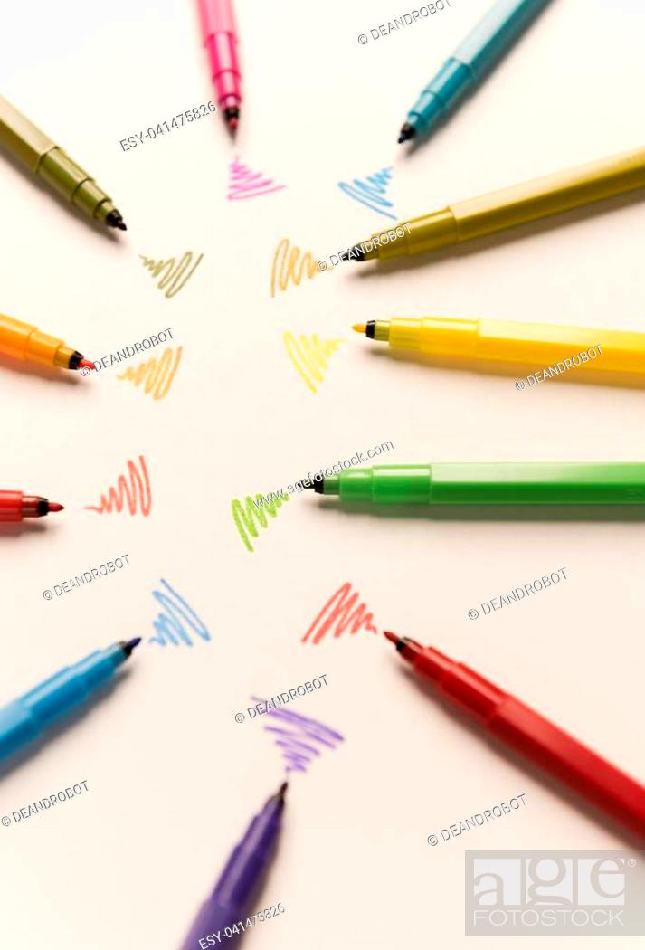 Stock Photo: Strokes painted with colorful markers on white paper. Markers sending out wi-fi.