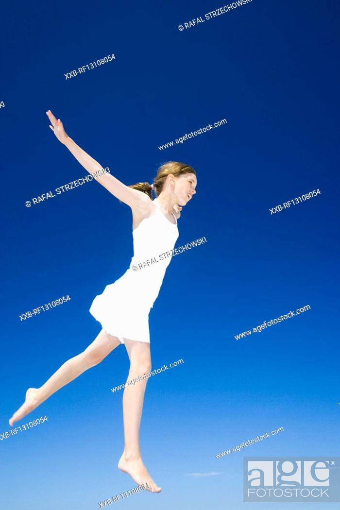 Stock Photo: girl jumping.