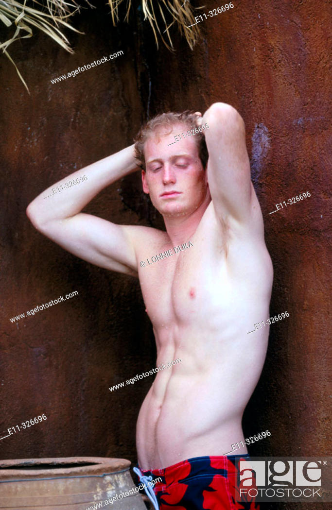 Stock Photo: Portrait of 21 year old man wearing bathing suit.