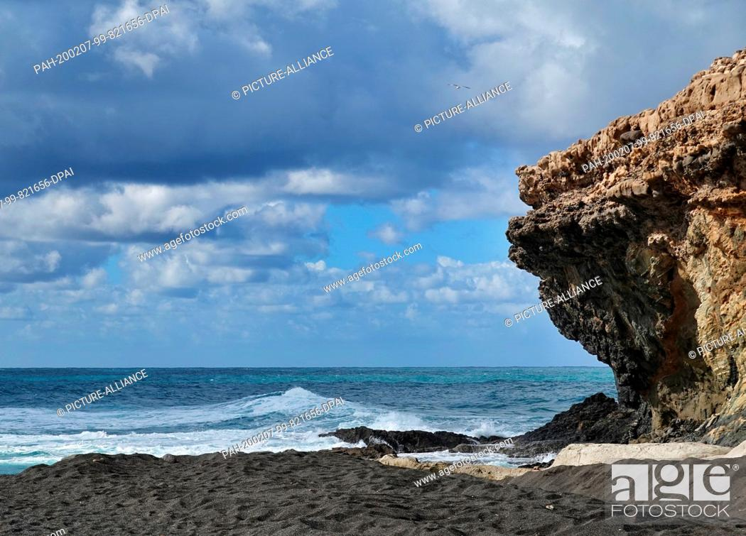 Stock Photo: 06 December 2019, Spain, La Pared: Black sand at Mirador La Pared on the Atlantic coast in the west of the island. Photo: Soeren Stache/dpa-Zentralbild/ZB.
