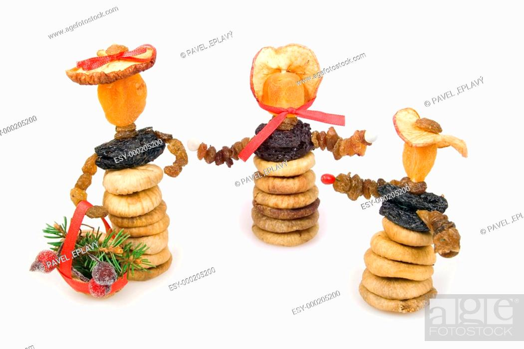 Stock Photo: Three dried-fruit Christmas dolls.