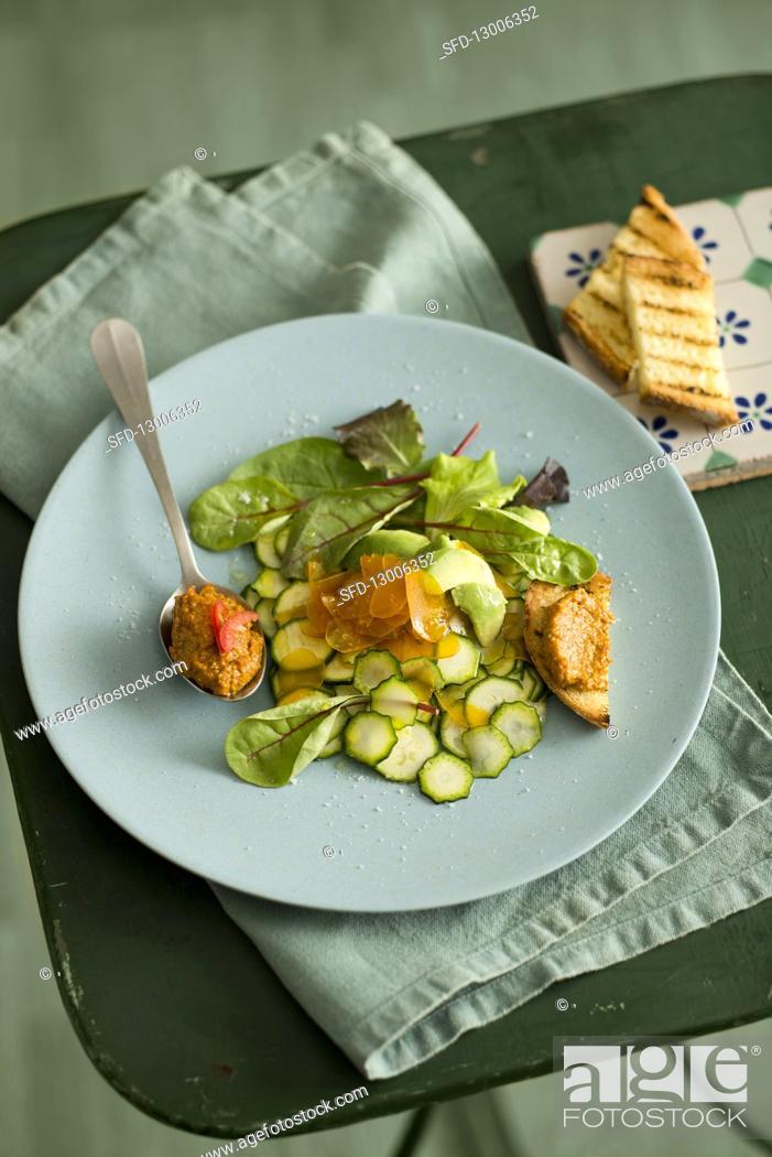 Stock Photo: Courgette salad with avocado, bottarga and tomato pesto.