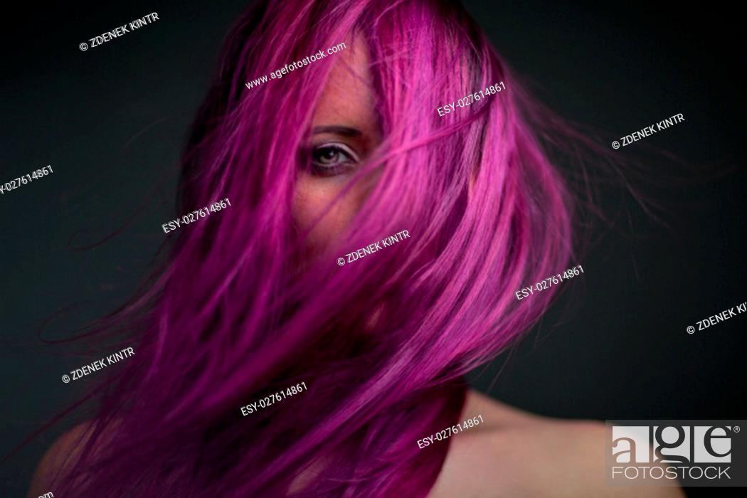 Stock Photo: portrait attractive girl with styling violet hair.