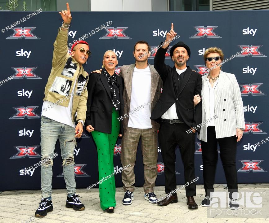 Stock Photo: Rapper Sfera Ebbasta, singer Malika Ayane, tv conducer Alessandro Cattelan, singer Samuel, record producer Mara Maionchi during the photocall of X Factor 2019.