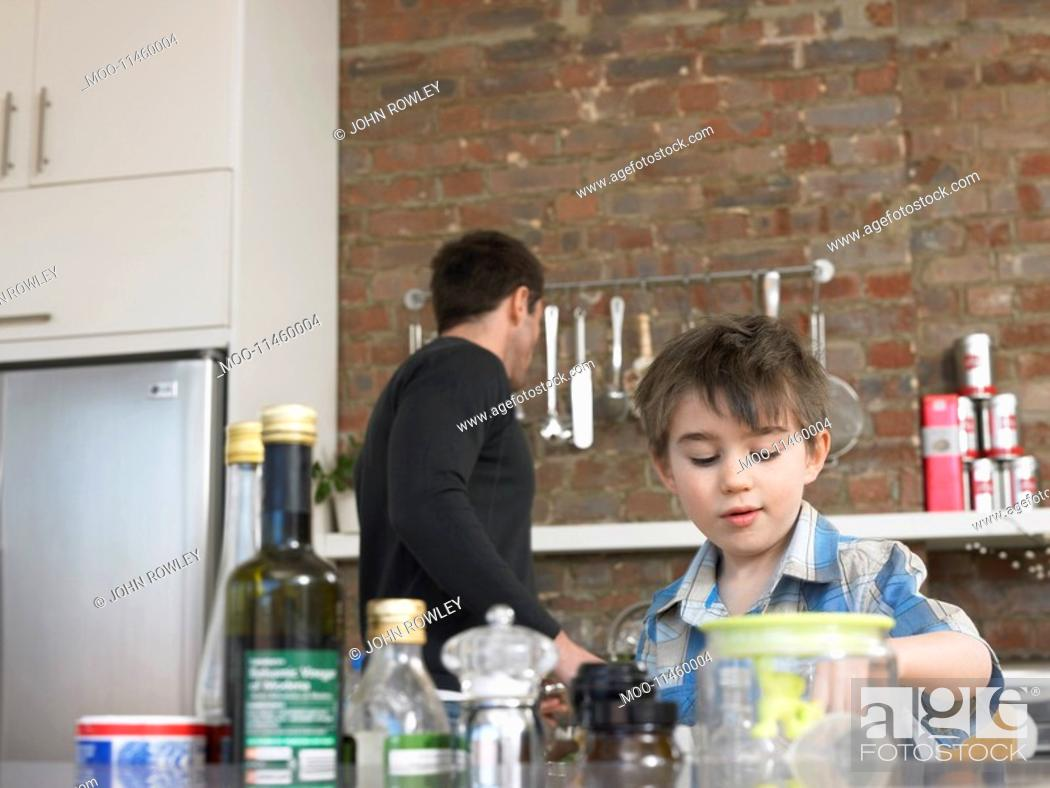 Stock Photo: Father and son 3-4 in kitchen.
