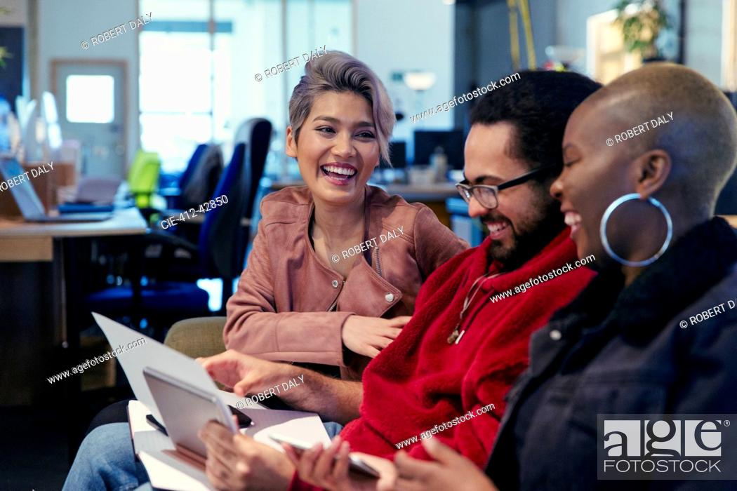Stock Photo: Laughing creative business people working in office.