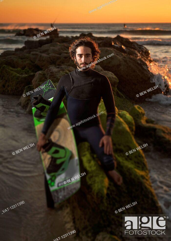 Imagen: Kitesurfing professional, Maxi Gomez, on the beach at sunset; Tarifa, Cadiz, Costa de la Luz, Andalusia, Spain.