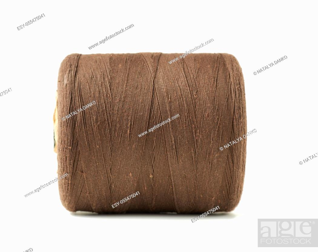 Stock Photo: large spool with brown cotton thread isolated on white background, close up.