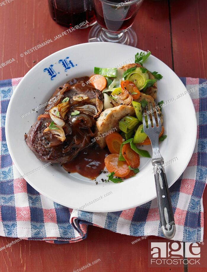 Stock Photo: Hearty cabbage soup with beef roast, bread dumplings and vegetables (Austria).